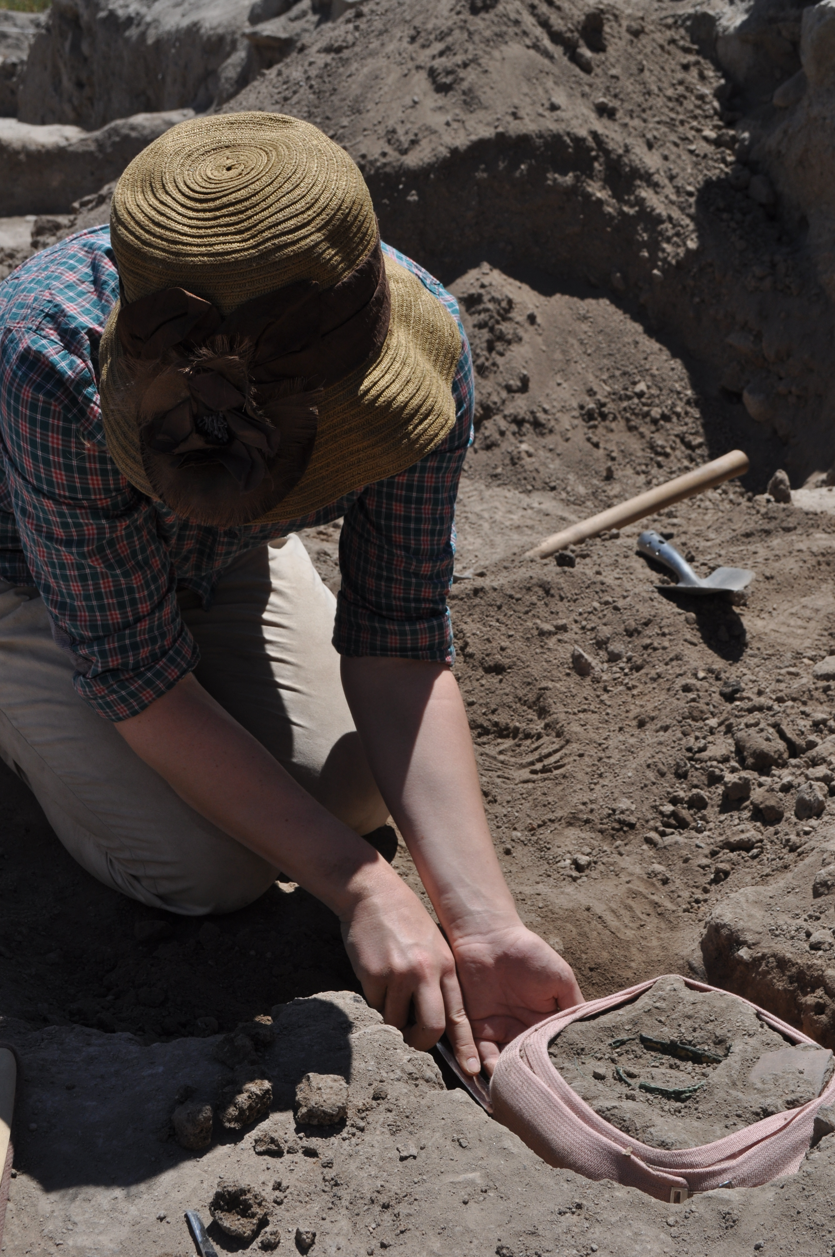 Kayleigh Fuller lifting a Bronze object at an archaeological dig in  Kaman Kalehöyük, 2012